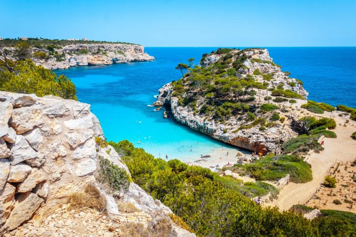 Calo des Moro, Mallorca on a sunny day with people on the beach