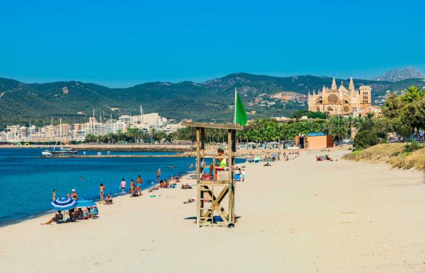 Beach in Palma de Majorca with view of Cathedral La Seu, Spain Balearic Islands